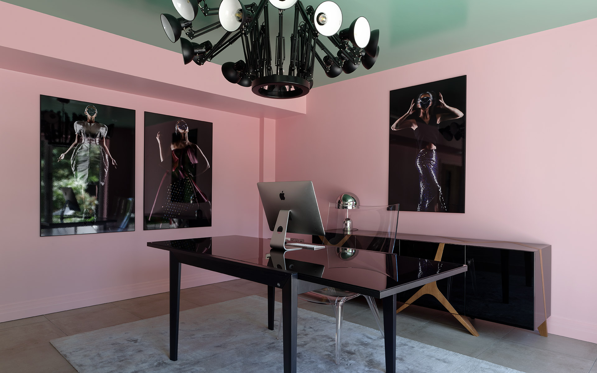 Pink and mint green office with artwork adorning walls. ArtbyReem