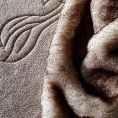 Bespoke engraved carpet and faux fur detail. Harrison Varma