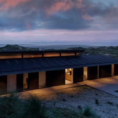 Sunset over a summer house, Fanø, Denmark. Architecture by Knud Holscher. Interior Design by Tollgård Design Group