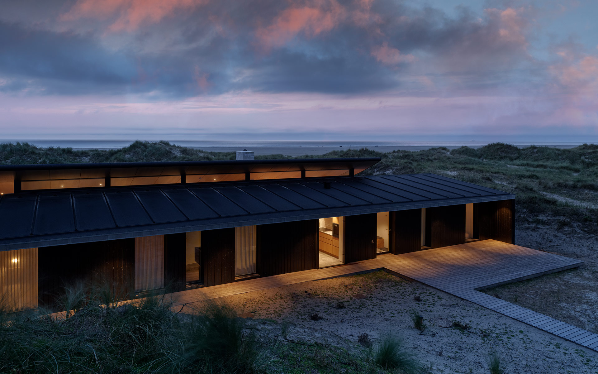 Sunset view over Architectural single storey summer house on the isle of Fano, denmark