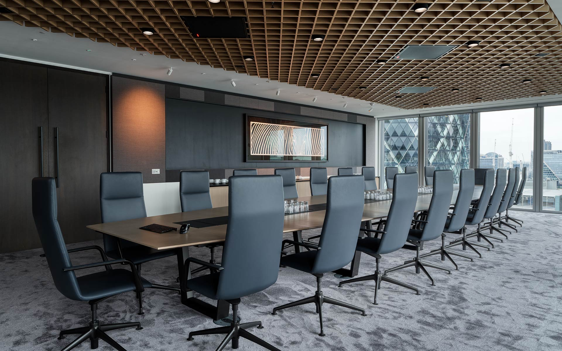 Long boardroom table with latticed ceiling and views to the Gherkin and City of London