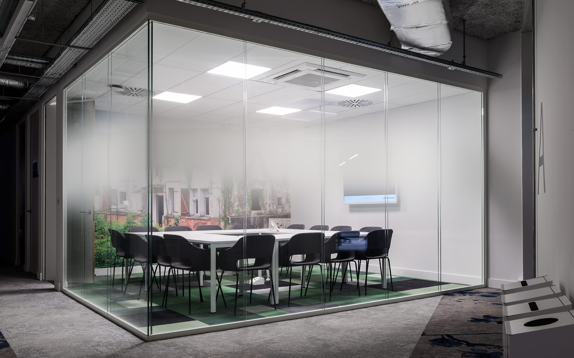 Glazed meeting room with fine art wallpaper