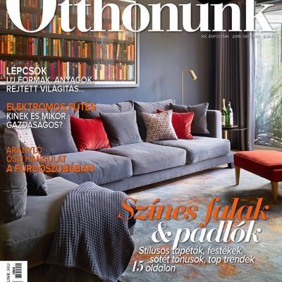 Front cover interiors photography of Ottonunk Magazine October 2019. Sofa with cushions, artwork above and rug and blanket in foreground